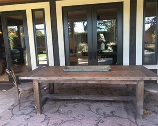 Restoration Hardware table and outdoor rug