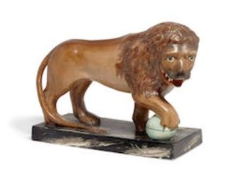 """A Staffordshire glazed earthenware figure of a Medici Lion - late 18th or early 19th century. 8.25""""h x 11.5""""l valued at $1000 - $1500 asking $600"""