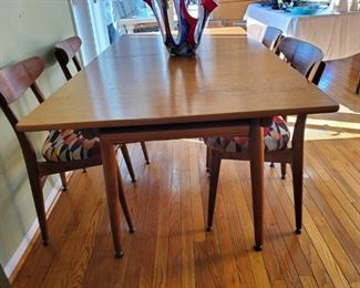 1950's Hans J. Wegner table and chairs are in excellent 70 year old condition! They have been reupholstered which you can redo as well!