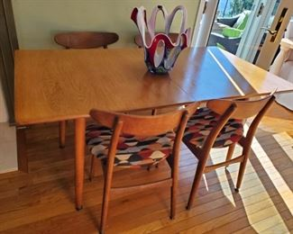 Hans J. Wegner-DENMARK..Table has leaves underneath that UNFOLD to create a large dining room set. THIS EXACT set is on 1rst Dibs for $20,000!!! But not HERE!