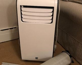 Like new free standing a/c. $100