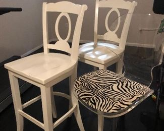 Acrylic chair. $45 Wooden chairs.  $20 eaxh