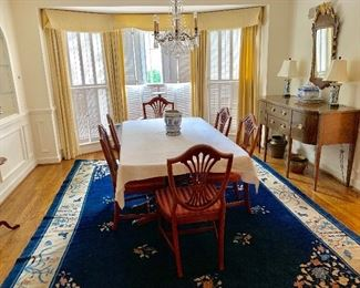 Baccarat chandelier, dining room table and chairs