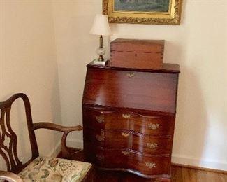 Slant front, serpentine desk, closed