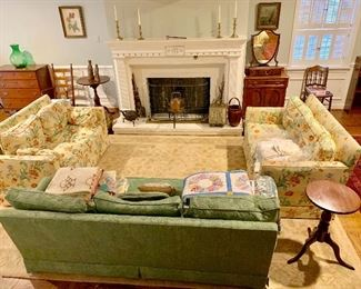 Another living room filled with antiques and collectibles
