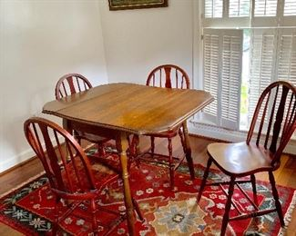 Drop leaf table with 4 red, distressed chairs