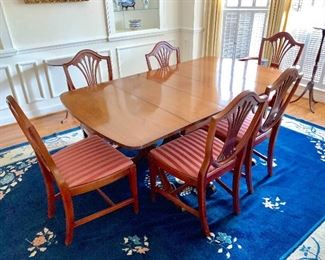 Large drop leaf dining room table with 6 shield back chairs