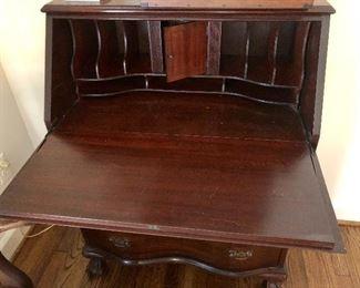 Slant front, serpentine desk, open