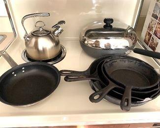 Cast iron pots , pans