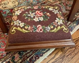 Needlepoint foot rest with casters