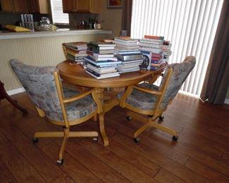 Oval Dinette set, double pedestal base, 4 really comfy arm chairs on castors