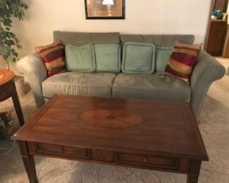 Contemporary wood coffee table and Natuzzi Sofa