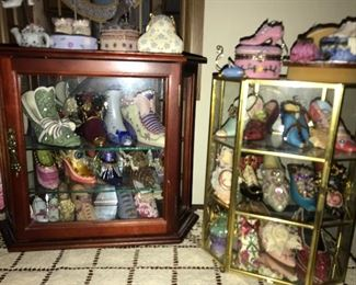 A large collection of Victorian Shoe collectibles and display cases.