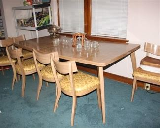 Very very unique Laminate mid century modern dinette set.  Very heavy, very cool.   Table, leafs, six chairs and hutch.