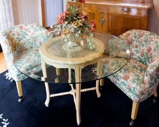 glass table and barrel chairs