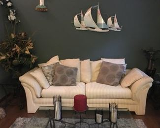 """Beautiful Plush Sofa, Large """"Throw"""" Pillows, Large Glass-top Coffee Table and Decorative Items"""