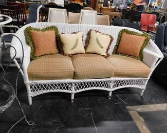 Upscale White wicker sofa with cushions & pillows