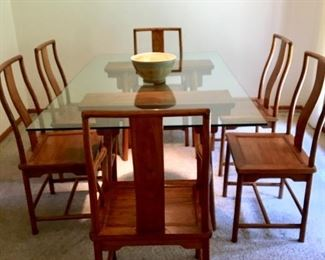 Solid wood/glass Dining table with six chairs. Workmanship is incredible. The wood is either take or a walnut and the grain is beautiful. $1250.00 firm.