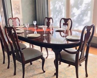 Thomasville dining table with two inserts and six chairs.