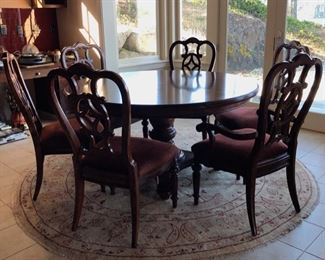 7-foot round table with 6 chairs and 1 insert