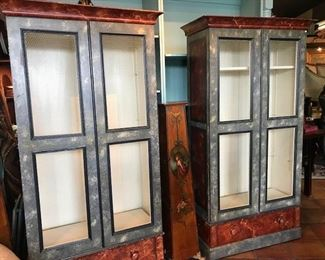 Faux painted cabinets/shelves with chicken wire in doors.