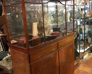 Gorgeous curved glass topped display cabinet- very fine. Lighted