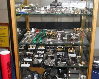Sterling Silver jewelry, Olympus cameras, watches, fountain pens, etc.