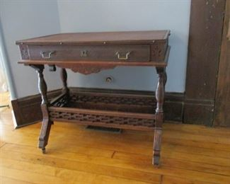 Walnut Parlor Table/Desk with Drawer and Shelf.  Original finish on wood and original hardware.  Blotter on top was replaced long ago.  Purchased in St. Joseph, Missouri at Carbry family sale, at 1 Carbry Place.