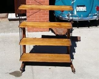 Antique Oak and Iron Baker Rack / Table.  Picture 1 of 3 which show the conversion from Rack to Table.   These are not seen very often.  When bread was baked, a baker would lay it on the table, then when cool, would turn the table upward creating shelves holding the bread to be sold.