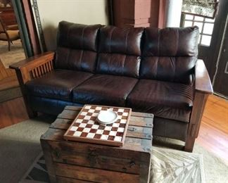 Genuine Leather Sofa with Craftsman style detailing in oak.  Very gently used to watch others playing pool in the Sun Room.  This is not antique but is a convincing reproduction of a Craftsman piece - and less age.  (The trunk is not being sold.)