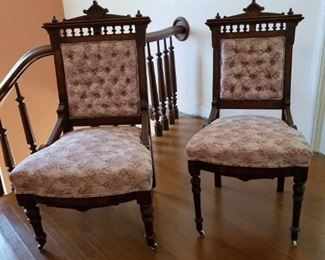 """Victorian """"His and Hers"""" chairs.  Antique in walnut.  Some wear on the upholstery.  (And yes, his has the smaller seat because he wasn't wearing a bustle on his skirt.)"""