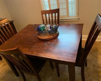 Solid wood dining table. 4 dining chairs.