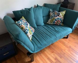 Futon Sofa. Hardwood legs.  All same color cushions must be sold with the futon.