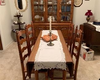 Drop leaf narrow table with 4 ladderback chairs China cabinet