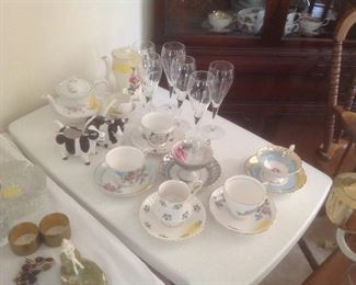 Cups and saucers with glass items