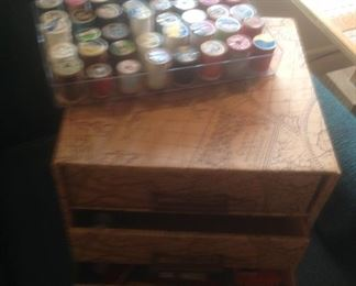 Sewing drawers filled with sewing items...also a tray of spools of thread