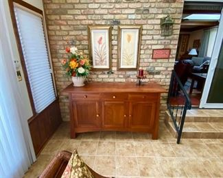 Along the back wall is an Ethan Allen credenza - it's gorgeous and in mint condition