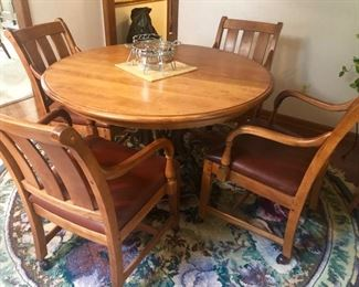 This is the Ethan Allen Table & Chairs Set - we have it displayed at the house with the leaf in - but this as you can see makes a great game table or dinette, too.  Expertly crafted.
