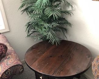 Various end tables and a couple standing plants