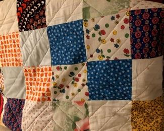 Various hand-made quilts