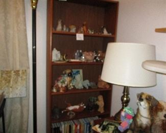Teak bookcase and assorted small bull dog figurines
