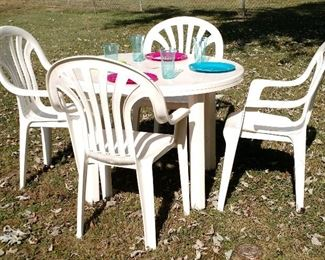 One of Three exterior/interior round outdoor Table with matching Chairs.