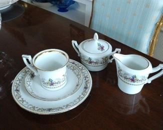 Six Demitasse cups , saucers ,dessert plates with sugar and creamer