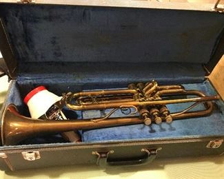 Vintage King Liberty white trumpet. Brass. Professional-level. Excellent condition with no dents, all slides move, excellent compression, fast action. 2 mutes, 2 mouthpieces. Music holder. In good condition case. Silent Auction.