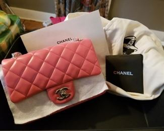 Chanel purse still in wrap with original box and cover