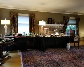 This grand room has an exceptional wool Persian rug, brass lion foot game table with drawers around