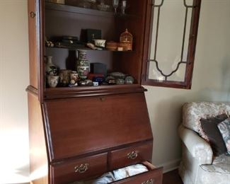 A hutch with lots of pretty whatchamacallits.