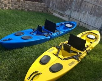 two freedom hawk stand up fishing  kayaks each with electric motor and fish finder