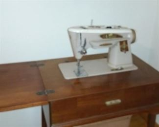 Singer sewing machine with cabinet and stool