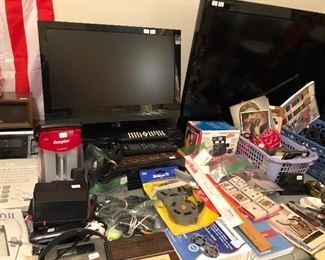 Small flat screen TVs, office supplies, radios, telephones.